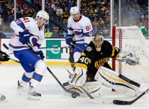 Boston Bruins' Tuukka Rask (40) clears the puck beside Montreal Canadiens' Paul Byron (41) during the third period of the NHL Winter Classic hockey game at Gillette Stadium in Foxborough, Mass., Friday, Jan. 1, 2016. The Canadiens won 5-1. (AP Photo/Michael Dwyer)