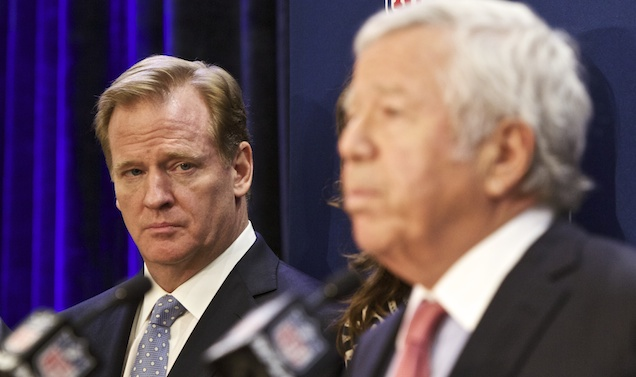 NFL commissioner Roger Goodell, left, looks on as New England Patriots owner Robert Kraft speaks at an NFL press conference announcing new measures for the league's personal conduct policy during an owners meeting, Wednesday, Dec. 10, 2014, in Irving, Texas. (AP Photo/Brandon Wade)